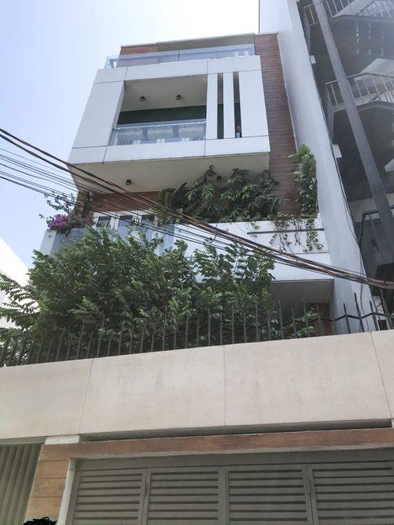 Cần bán căn lạc long quân nhà trệt 2 lầu có sân thượng